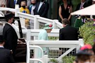 <p>The crowd erupted in a huge cheer upon their first sighting of the monarch.</p>