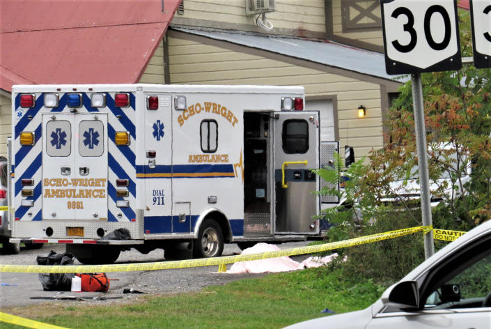 In this Saturday, Oct. 6, 2018 photo, a body is draped under a blanket at the scene of a fatal crash in Schoharie, N.Y. (Tom Heffernan Sr. via AP)