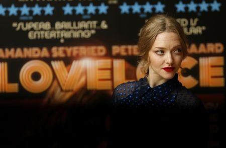Actress Amanda Seyfried poses for photographers before a screening of her new film Lovelace at a hotel in Mayfair, London