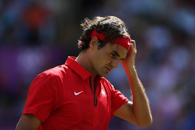 LONDON, ENGLAND - AUGUST 05: Roger Federer of Switzerland reacts during the Men's Singles Tennis Gold Medal Match against Andy Murray of Great Britain on Day 9 of the London 2012 Olympic Games at the All England Lawn Tennis and Croquet Club on August 5, 2012 in London, England. (Photo by Clive Brunskill/Getty Images)