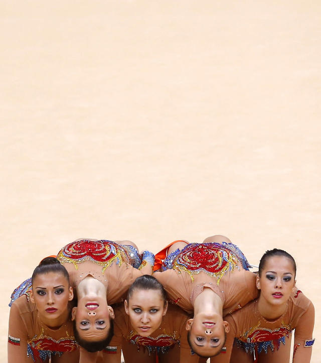 The Bulgaria team compete in their group all-around gymnastics final match at the Wembley Arena during the London 2012 Olympic Games August 12, 2012. REUTERS/Mike Blake (BRITAIN - Tags: OLYMPICS SPORT GYMNASTICS TPX IMAGES OF THE DAY)
