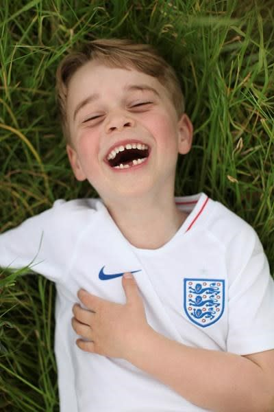 LONDON — Kensington Palace has released three new photographs before Prince George's birthday.The future king turns 6 on Monday. It's become a tradition for the palace to release snapshots taken by his mother Kate, the Duchess of Cambridge.In two of the pictures George is seen with a big smile as he wears an English soccer jersey. The third shows him on a family holiday.George is third in line for the throne behind his grandfather Prince Charles and his father Prince William.He is a great-grandson of Queen Elizabeth II.The Associated Press
