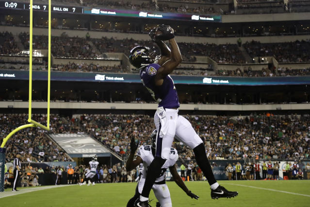 Baltimore Ravens' Jaleel Scott, top, catches a touchdown against Philadelphia Eagles' Jeremiah McKinnon (38) during the first half of a preseason NFL football game, Thursday, Aug. 22, 2019, in Philadelphia. (AP Photo/Michael Perez)