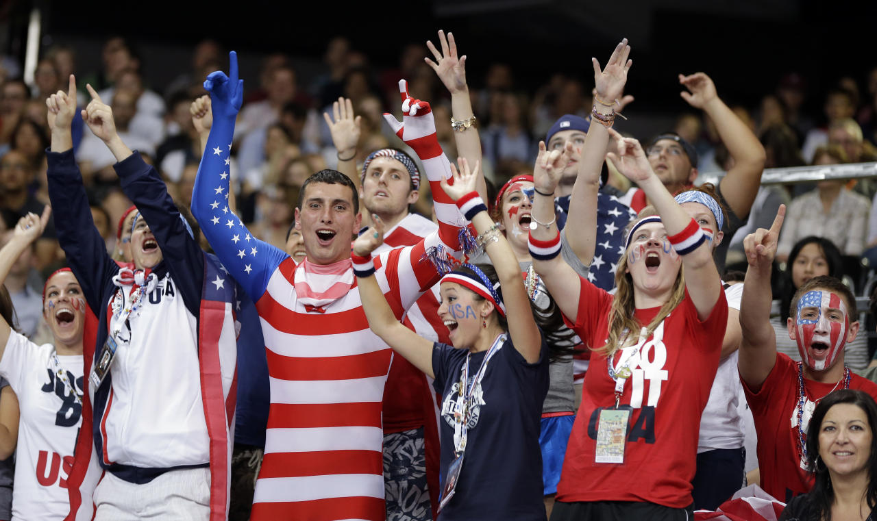 Fans cheer on the USA during a women's volleyball preliminary match against South Korea at the 2012 Summer Olympics Saturday, July 28, 2012, in London. (AP Photo/Chris O'Meara)