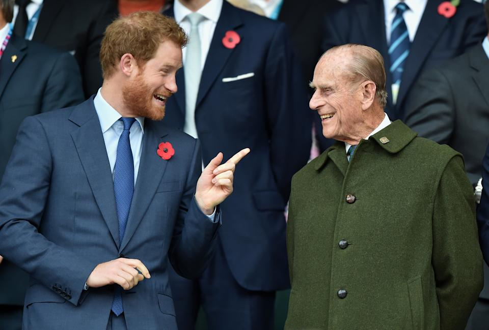 Prince Harry and Prince Philip laughing