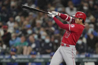Los Angeles Angels' Shohei Ohtani strikes out swinging during the seventh inning of a baseball game against the Seattle Mariners, Sunday, Oct. 3, 2021, in Seattle. (AP Photo/Ted S. Warren)