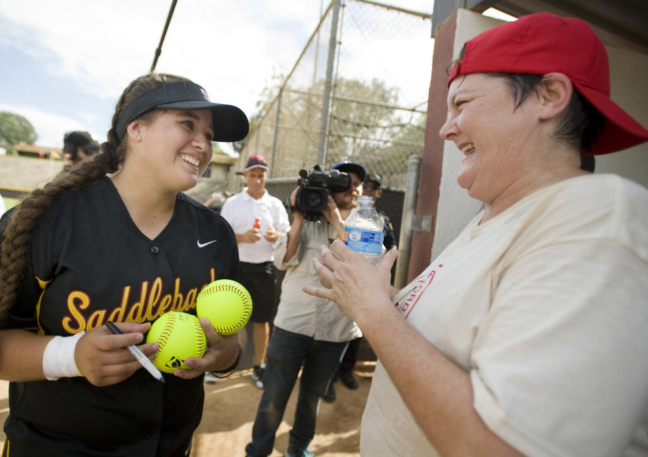 "MISSION VIEJO, CA - OCTOBER 14: ""A League of their Own,"" movie actress Megan Cavanagh who played ""Marla Hooch,"" in the 1992 film starring Tom Hanks, signs autographs for Saddleback College baseball players after an exhibition game.    ///ADDITIONAL INFO: - Photo by MINDY SCHAUER,  The Orange County Register/MediaNews Group via Getty Images -   shot: 101415  TomHanks.1015    Director Penny Marshall and cast members from the movie, ""A League of their Own,"" play an exhibition baseball game with ESPN.W and Saddleback College softball players. The event was sponsored by the Bentonville Film Festival and ESPN.W."" (Photo by Mindy Schauer/Digital First Media/Orange County Register via Getty Images)"
