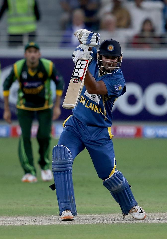 DUBAI, UNITED ARAB EMIRATES - DECEMBER 20:  Kumar Sangakkara of Sri Lanka bats during the second One-Day International (ODI ) match between Sri Lanka and Pakistan at the Dubai Sports City Cricket Stadium on December 20, 2013 in Dubai, United Arab Emirates.  (Photo by Francois Nel/Getty Images)