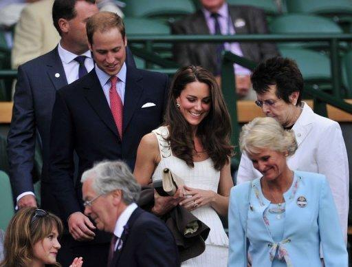 Prince William (2nd L) and his wife Catherine the Duchess of Cambridge (C) arrive on Centre Court