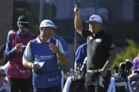 Sungjae Im, right, consults with his caddie about an approach shot during the Shriners Children's Open golf tournament, Sunday, Oct. 10, 2021, at TPC Summerlin in Las Vegas. (AP Photo/Sam Morris)