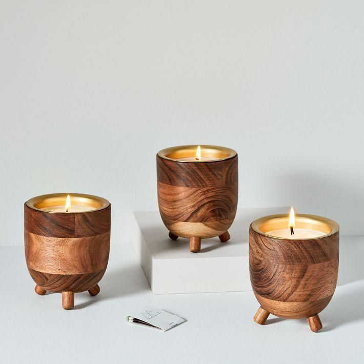 """<p><strong>West Elm</strong></p><p>westelm.com</p><p><strong>$12.99</strong></p><p><a href=""""https://go.redirectingat.com?id=74968X1596630&url=https%3A%2F%2Fwww.westelm.com%2Fproducts%2Frewined-barrel-candles-d5317&sref=https%3A%2F%2Fwww.oprahdaily.com%2Flife%2Fg23584712%2Fbest-scented-candles%2F"""" rel=""""nofollow noopener"""" target=""""_blank"""" data-ylk=""""slk:SHOP NOW"""" class=""""link rapid-noclick-resp"""">SHOP NOW</a></p><p>When the wick burns out on this spiked cider candle, repurpose the barrel.</p>"""