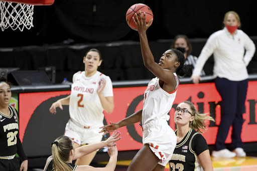 Maryland guard Diamond Miller (1) shoots in front of Purdue defenders during the second half of an NCAA college basketball game, Sunday, Jan. 10, 2021, in College Park, Md. (AP Photo/Will Newton)
