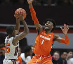 Virginia Tech; Jalen Cone (15) looks to pass around Syracuse's Quincy Guerrier (1) during the first half of an NCAA college basketball game in Blacksburg Va., Saturday, Jan. 18 2020. (Matt Gentry/The Roanoke Times via AP)