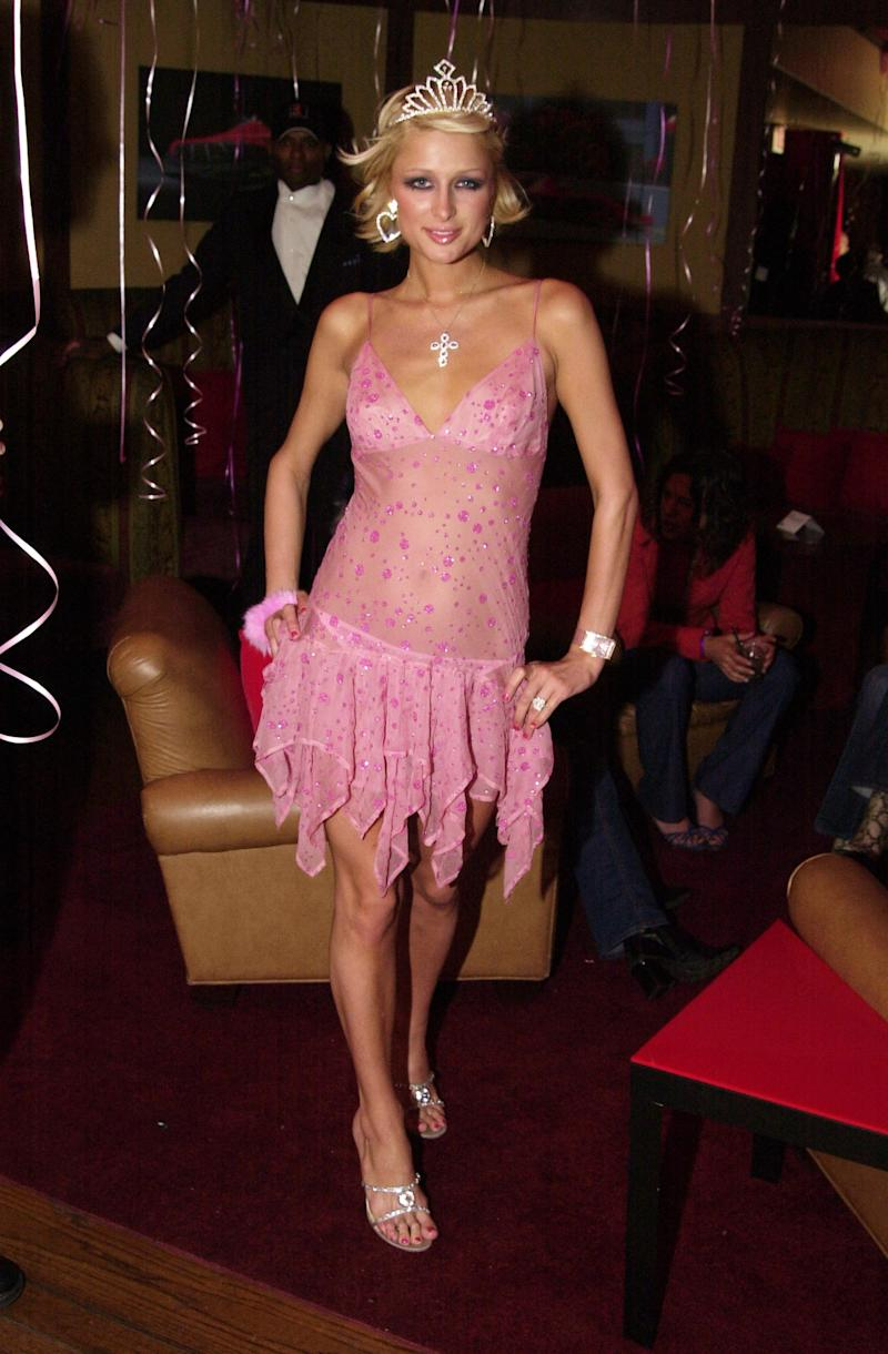 Paris Hilton wore a see-through pink dress and tiara to the California celebration of her 21st birthday at the GQ Lounge in Los Angeles.