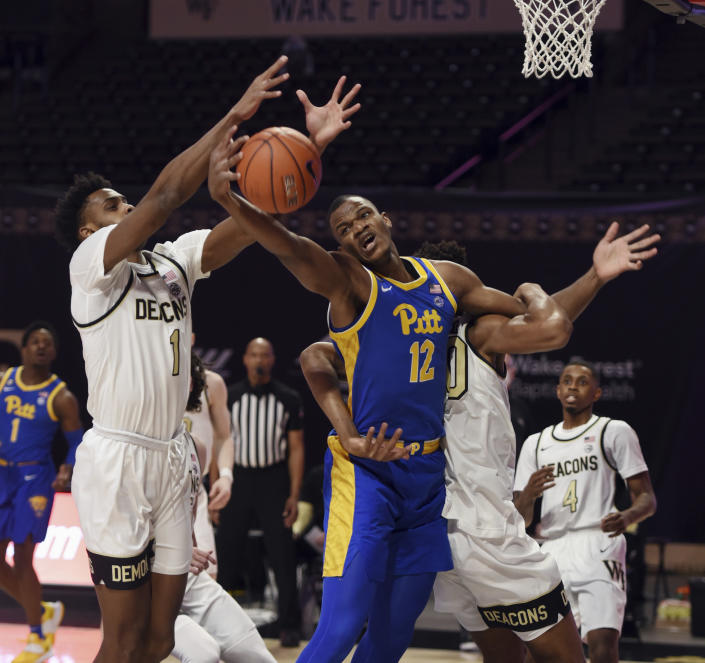 Pittsburgh's Abdoul Karim Coulibaly vies with Wake Forest's Isaiah Mucius (1) and Emmanuel Okpomo for a rebound during an NCAA college basketball game Saturday, Jan. 23, 2021, in Winston-Salem, N.C. (Walt Unks/The Winston-Salem Journal via AP)