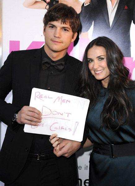 Ashton Kutcher with wife Demi Moore. If your wondering what Ashton's sign is referring to then check out change.org for info on ending human trafficking. Photo: Wireimage.com