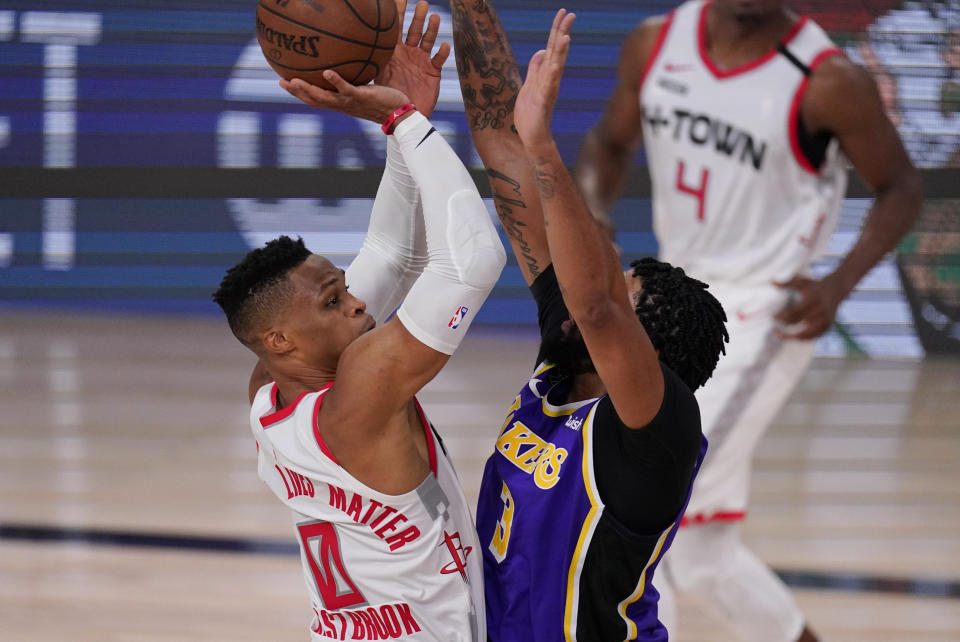 Houston Rockets' Russell Westbrook (0) shoots over Los Angeles Lakers' Anthony Davis (3) during the first half of an NBA conference semifinal playoff basketball game Friday, Sept. 4, 2020, in Lake Buena Vista, Fla. (AP Photo/Mark J. Terrill)