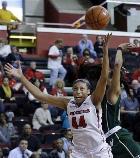 Rutgers' Betnijah Laney (44) grabs for the ball in front of South Florida's Andrea Smith during the first half of an NCAA college basketball game Tuesday, Feb. 26, 2013, in Piscataway, N.J. (AP Photo/Mel Evans)