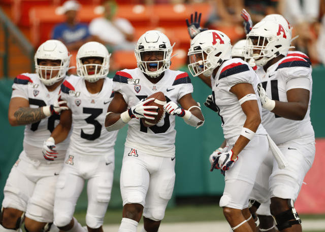 Arizona wide receiver Jamarye Joiner (10) celebrates with teammates after scoring a second-quarter touchdown against Hawaii during an NCAA college football game Saturday, Aug. 24, 2019, in Honolulu. (AP Photo/Marco Garcia)