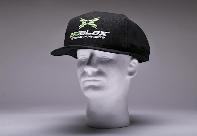 This product image released by Vizion Group on Tuesday, Jan. 28, 20134, shows the isoBLOX protective cap for professional baseball players. Major League Baseball has approved the protective cap for pitchers to reduce the effects of being hit in the head by line drives. (AP Photo/Vizion Group)