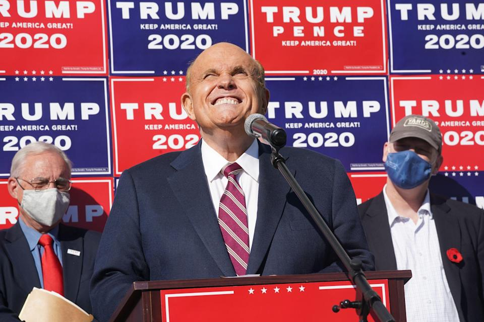 <p>Attorney for Donald Trump, Rudy Giuliani, speaks at a news conference in the parking lot of a landscaping company on November 7, 2020 in Philadelphia</p> (Photo by BRYAN R. SMITH/AFP via Getty Images)
