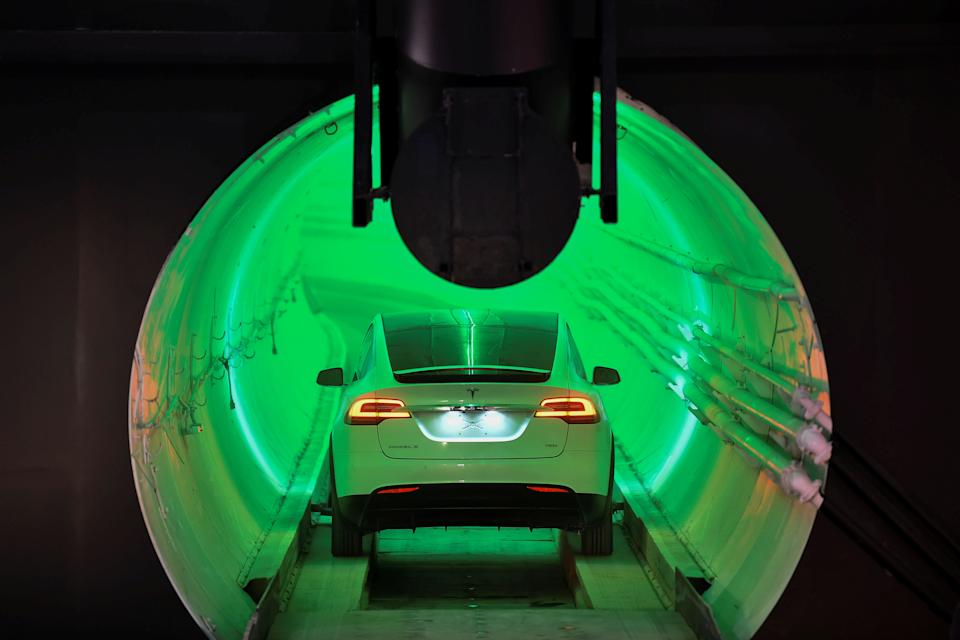 A modified Tesla Model X electric vehicle enters a tunnel during an unveiling event for the Boring Co. Hawthorne test tunnel in Hawthorne, California, U.S., December 18, 2018.        Robyn Beck/Pool via REUTERS