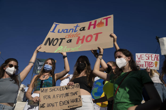 Students hold up a banners during a rally in front of the parliament in Athens, on Friday, Sept. 24 2021. Hundreds gathered at Syntagma square to protest against global warming and climate change. (AP Photo/Petros Giannakouris)