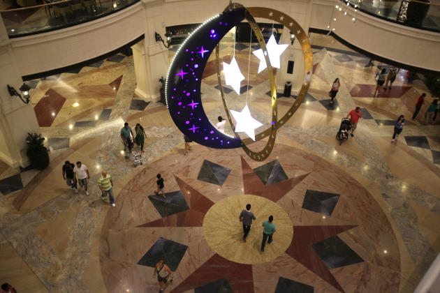 People Walk Inside A Shopping Mall With Ramadan Decorations
