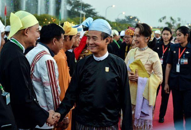 PHOTO: Myanmar's President Win Myint and Myanmar State Counsellor Aung San Suu Kyi arrive to attend a reception to mark the 72nd anniversary of country's National Union Day in Naypyidaw, Feb. 12, 2019. (Thet Aung/AFP/Getty Images)