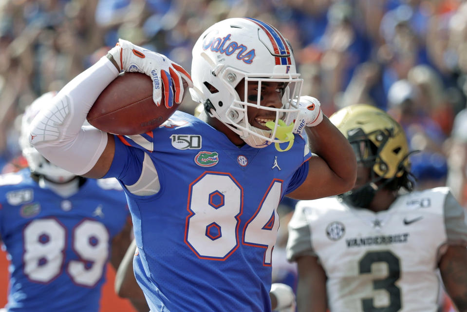 FILE - In this Nov. 9, 2019, file photo, Florida tight end Kyle Pitts (84) celebrates after scoring a touchdown on a 15-yard pass reception during the second half of an NCAA college football game against Vanderbilt, in Gainesville, Fla. Pitts was selected to The Associated Press All-Southeastern Conference football team, Monday, Dec. 9, 2019.(AP Photo/John Raoux, File)