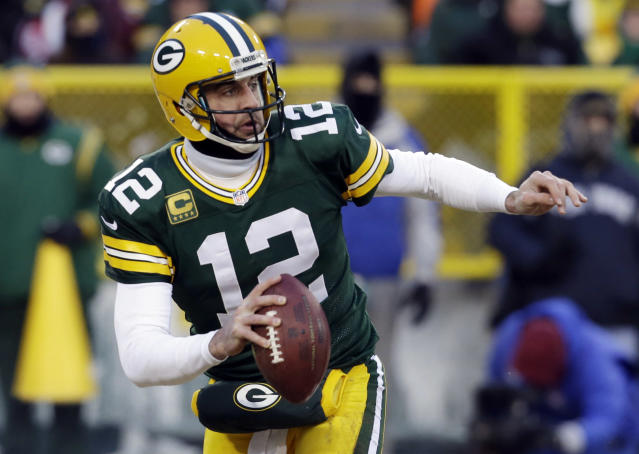 Green Bay Packers quarterback Aaron Rodgers (12) scrambles during the first half of an NFL wild-card playoff football game against the San Francisco 49ers, Sunday, Jan. 5, 2014, in Green Bay, Wis. (AP Photo/Mike Roemer)
