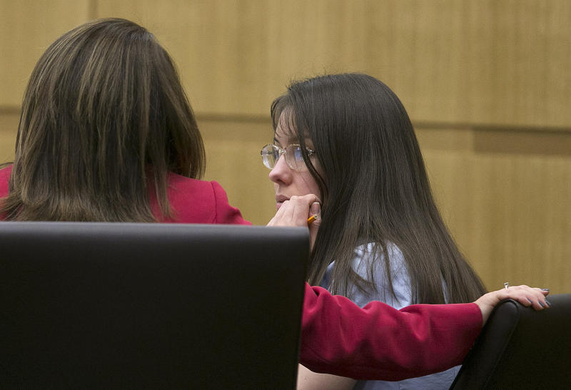 Jodi Arias speaks wither her attorney, Jennifer Wilmott, during her trial in Maricopa County court Tuesday, Jan. 8, 2013, in Phoenix. Arias is charged with murder in the death of her boyfriend, Travis Alexander, and prosecution is seeking the death penalty. (AP Photo/The Arizona Republic, David Wallace)