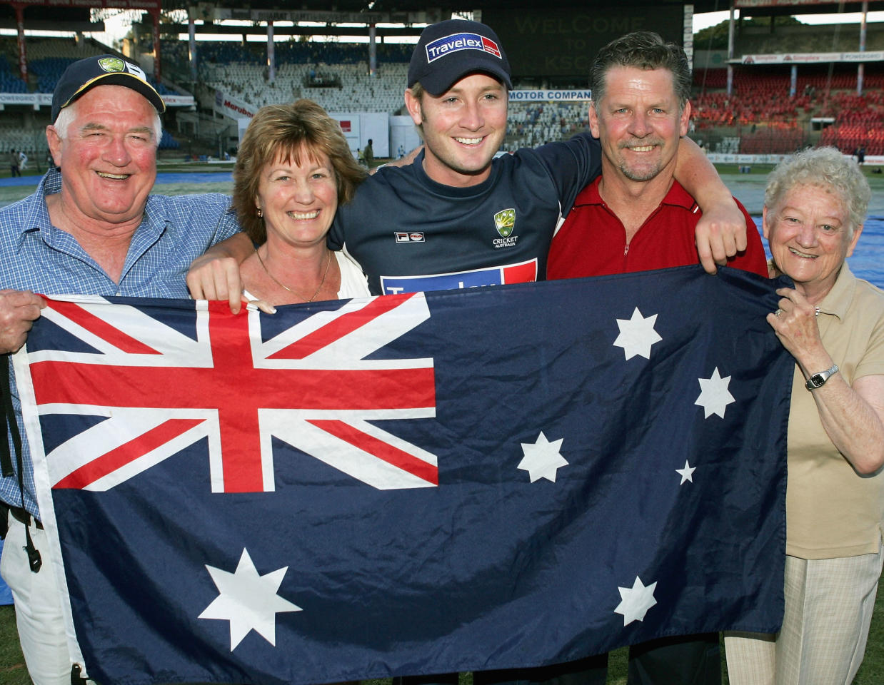 BANGALORE, INDIA - OCTOBER 7:  Michael Clarke of Australia with family (L - R) grandfather Ray, mother Debbie, Michael, father Les and grandmother June after Clarke made 151 on debut after day two of the First Test between India and Australia played at the Chinnaswamy Stadium on October 7, 2004 in Bangalore, India. (Photo by Hamish Blair/Getty Images)