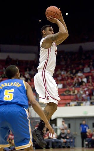 Washington State guard DaVonte Lacy (3) shoots as UCLA guard Jerime Anderson (5) watches during the first half of an NCAA college basketball game on Saturday, Feb. 4, 2012, in Pullman, Wash. (AP Photo/Dean Hare)