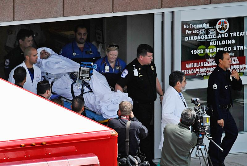 Bryan Stow, escorted by his neurosurgeon Dr. Gabriel Zada (C) and medical staff, is taken from Los Angeles County-USC Medical Center to Bob Hope Airport for a trip to San Francisco General Hospital, on May 16, 2011 in Los Angeles, California