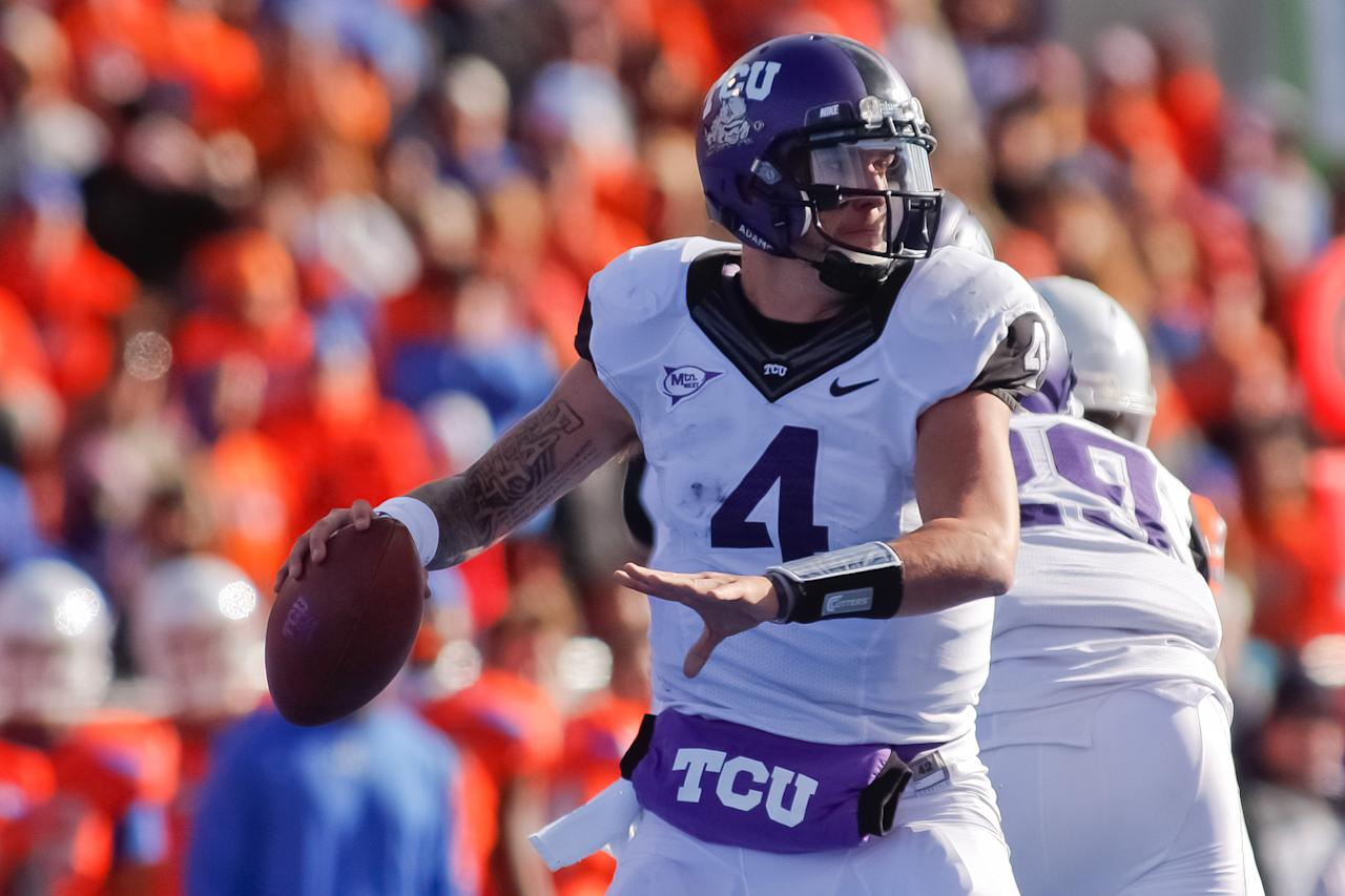 BOISE, ID - NOVEMBER 12:  Casey Pachall #4 of the TCU Horned Frogs looks for a receiver against the Boise State Broncos at Bronco Stadium on November 12, 2011 in Boise, Idaho.  (Photo by Otto Kitsinger III/Getty Images)