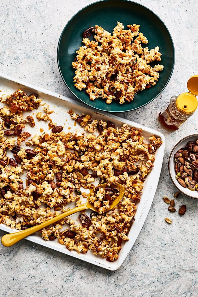 """<p>Sweet, salty, crunchy, and seriously addictive, this popcorn's just the thing for snacking on during the game. To make it even more perfect for fall entertaining, swap in pumpkin seeds for the nuts and add a sprinkle of cinnamon. </p> <p><strong>Get the recipe</strong>: <a href=""""https://www.realsimple.com/food-recipes/browse-all-recipes/honey-nut-popcorn-recipe"""" target=""""_blank"""">Honey Nut Popcorn</a></p>"""