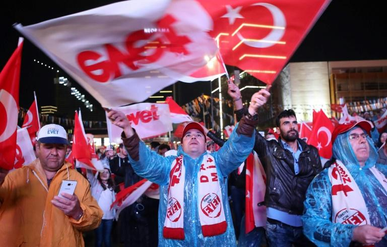 Supporters of Turkish President Recep Tayyip Erdogan celebrate as the 'Yes' camp claims victory in a referendum on changes to the constitution to give him greater powers
