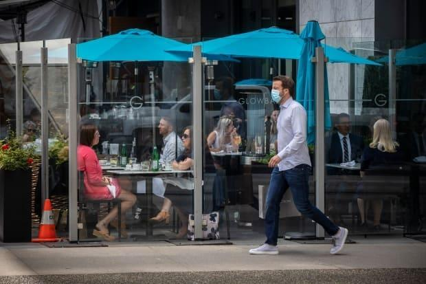 Diners are pictured eating at a restaurant in downtown Vancouver, British Columbia on Tuesday, June 22, 2021.  (Ben Nelms/CBC - image credit)