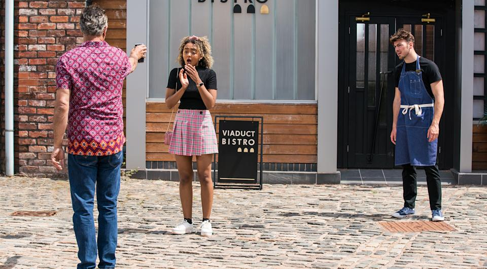 FROM ITV  STRICT EMBARGO - No Use before Tuesday 13th July 2021  Coronation Street - Ep 1038485  Friday 23rd July 2021   Dev Alahan [JIMMI HARKSHIN] brandishes the calendar picture at Curtis [SAM RETFORD] and Emma Brooker [ALEXANDRA MARDELL] and demands they put a stop to the print run.   Picture contact David.crook@itv.com   This photograph is (C) ITV Plc and can only be reproduced for editorial purposes directly in connection with the programme or event mentioned above, or ITV plc. Once made available by ITV plc Picture Desk, this photograph can be reproduced once only up until the transmission [TX] date and no reproduction fee will be charged. Any subsequent usage may incur a fee. This photograph must not be manipulated [excluding basic cropping] in a manner which alters the visual appearance of the person photographed deemed detrimental or inappropriate by ITV plc Picture Desk. This photograph must not be syndicated to any other company, publication or website, or permanently archived, without the express written permission of ITV Picture Desk. Full Terms and conditions are available on  www.itv.com/presscentre/itvpictures/terms