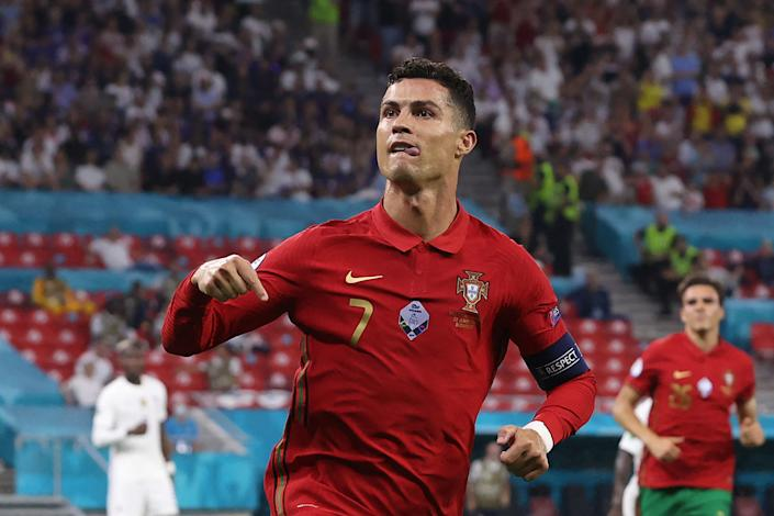 Cristiano Ronaldo celebrates after tying the international men's scoring record with his 109th goal for Portugal. (Photo by BERNADETT SZABO/POOL/AFP via Getty Images)