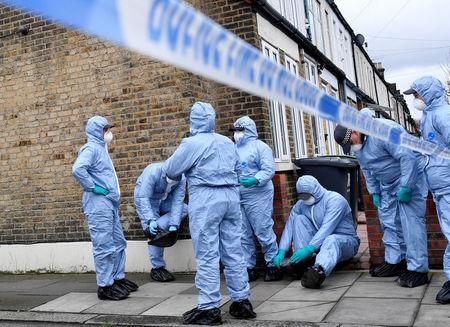 Forensic investigators get dressed into their protective equipment at the end of Chalgrove Road, where a teenage girl was murdered, in Tottenham, Britain, April 3, 2018. REUTERS/Toby Melville