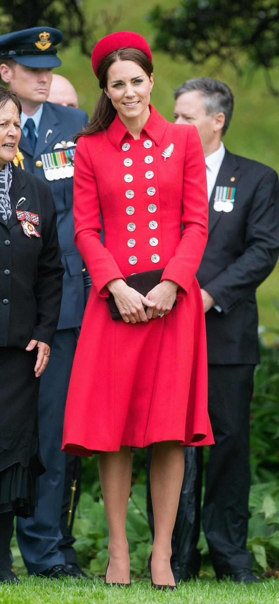<p>Kate, William and Prince George are welcome into New Zealand with Kate wearing a rich red ensemble by royal favourite, Catherine Walker. The Duchess also wore a matching pillbox hat from Gina Foster.</p><p><i>[Photo: PA]</i></p>