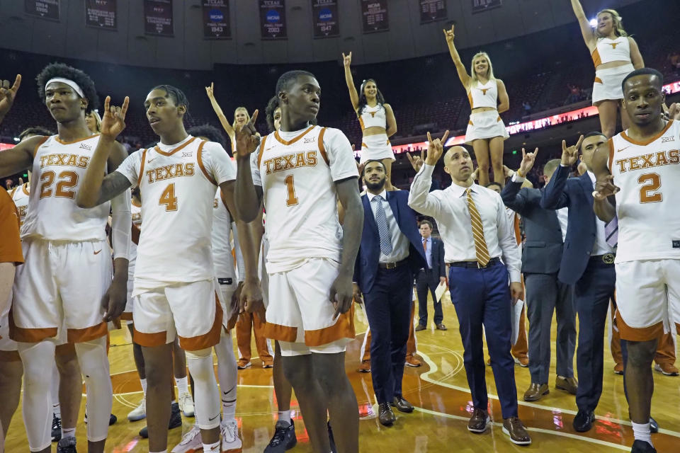 "Texas head coach, Shaka Smart, center right, listens to the ""Eyes of Texas"" song with his team after an NCAA college basketball game against Iowa State, Saturday, Feb. 1, 2020, in Austin, Texas. Texas won 72-68. (AP Photo/Michael Thomas)"