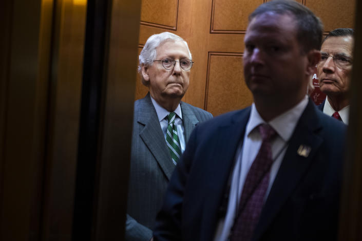 Senate Minority Leader Mitch McConnell, R-Ky., left, and Sen. John Barrasso, R-Wyo., right, head to a news conference in the Capitol on June 17.