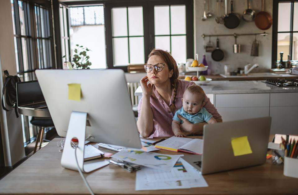 Mother with her baby boy working from home in days of isolation