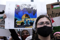 A demonstrator holding a sign takes part in a protest outside the Federal Building against Israel and in support of Palestinians, Saturday, May 15, 2021 in the Westwood section of Los Angeles. (AP Photo/Ringo H.W. Chiu)