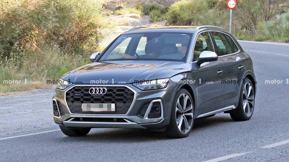 """<p>The sporty <a href=""""https://www.motor1.com/audi/sq5/"""" rel=""""nofollow noopener"""" target=""""_blank"""" data-ylk=""""slk:Audi SQ5"""" class=""""link rapid-noclick-resp"""">Audi SQ5</a> shows off more metallic trim on this development vehicle.</p> <h3><a href=""""https://www.motor1.com/news/432693/audi-sq5-facelift-spy-shots/"""" rel=""""nofollow noopener"""" target=""""_blank"""" data-ylk=""""slk:2021 Audi SQ5 Facelift Spied Without Any Camouflage"""" class=""""link rapid-noclick-resp"""">2021 Audi SQ5 Facelift Spied Without Any Camouflage</a></h3> <br><a href=""""https://www.motor1.com/news/313413/audi-s5-diesel-engine-rumor/"""" rel=""""nofollow noopener"""" target=""""_blank"""" data-ylk=""""slk:Audi S5 Lineup Rumored To Get Diesel Engine From SQ5 TDI"""" class=""""link rapid-noclick-resp"""">Audi S5 Lineup Rumored To Get Diesel Engine From SQ5 TDI</a><br><a href=""""https://www.motor1.com/news/306267/2019-audi-sq5-tdi-revealed/"""" rel=""""nofollow noopener"""" target=""""_blank"""" data-ylk=""""slk:2019 Audi SQ5 TDI Goes Official With Massive Torque"""" class=""""link rapid-noclick-resp"""">2019 Audi SQ5 TDI Goes Official With Massive Torque</a><br>"""