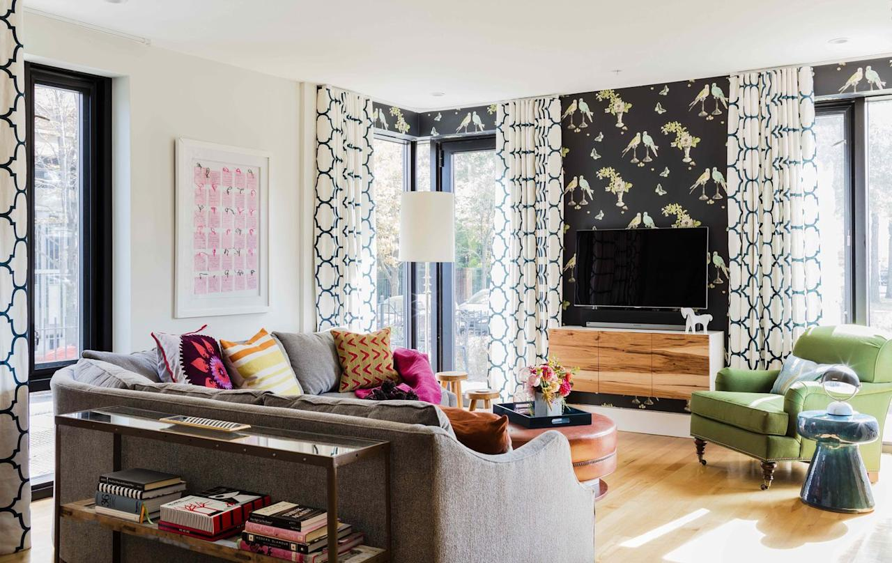"""<p>Mismatched patterns create an eclectic vibe in this bright living space by <a rel=""""nofollow"""" href=""""https://deringhall.com/interior-designers/kmid-kate-maloney-interior-design"""">KMID 