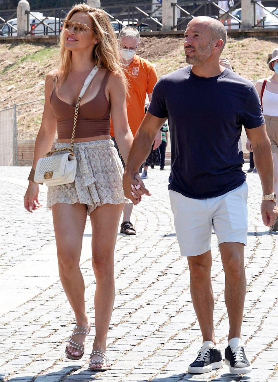 Chrishell Stause and Jason Oppenheim are spotted walking hand in hand while visiting the Colosseum and the Roman Forum before packing up and leaving Rome July 30, 2021